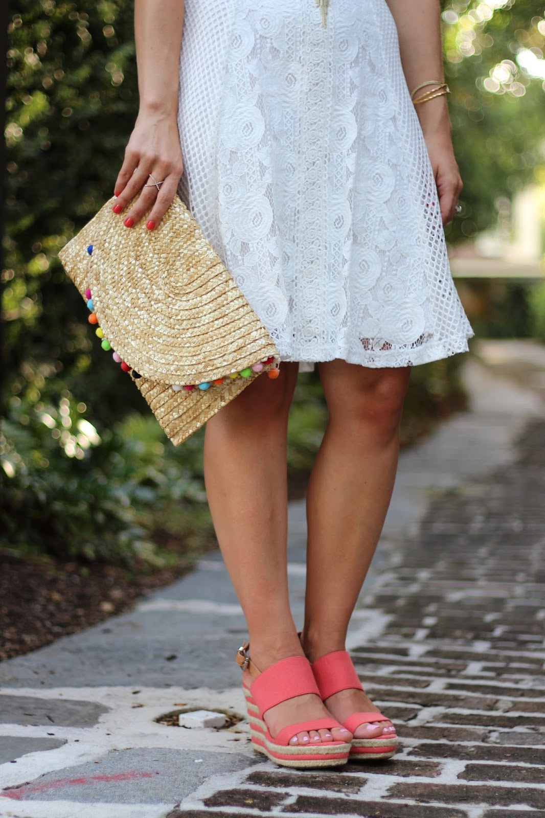 Carmelita natural pom pom clutch
