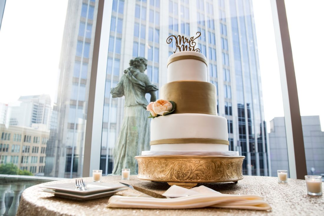 gold and white wedding cake wow factor cakes