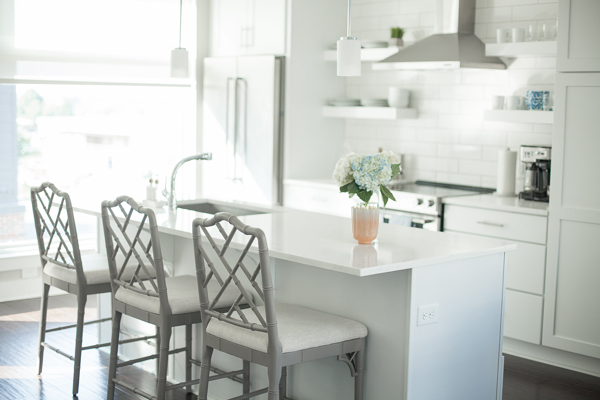 modern white kitchen, grey bamboo barstools