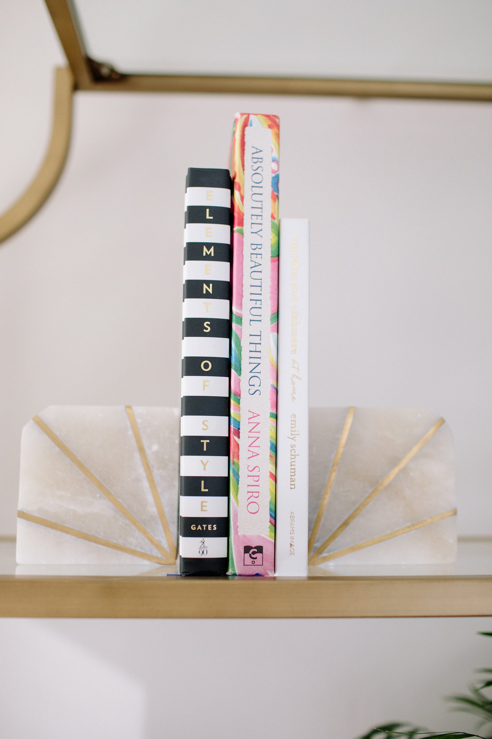 marble and gold bookends, coffee table books