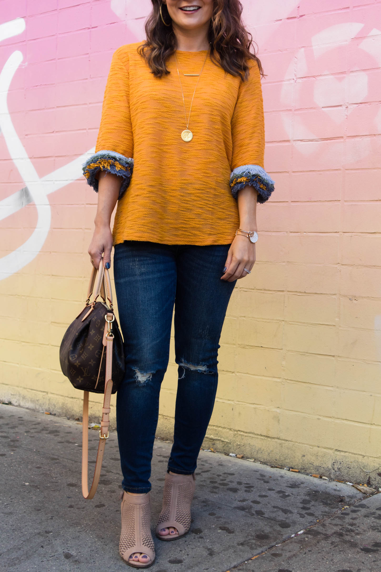 fringe sleeve sweater, distressed jeans under $100