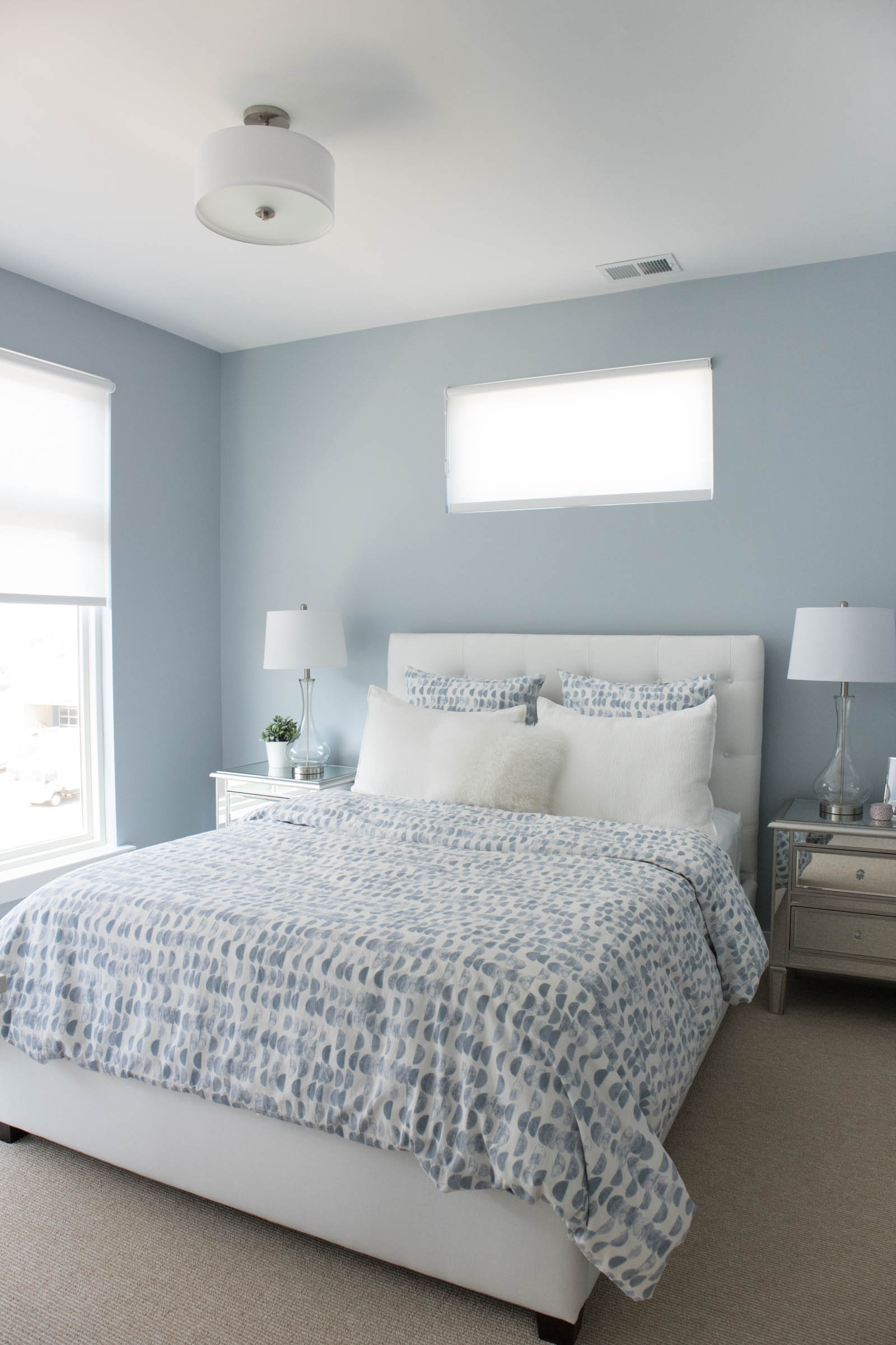 blue guest bedroom, white tufted bed